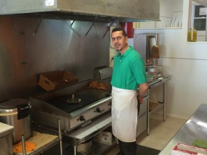 Abass, the older brother, does the cooking in Gyro Expresses tiny but immaculately clean kitchen